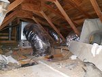A very poorly installed duct system leaking air in the attic.